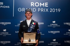 Ben Maher, the winner of the Grand Prix 1.60 with his prize a Longines timepiece